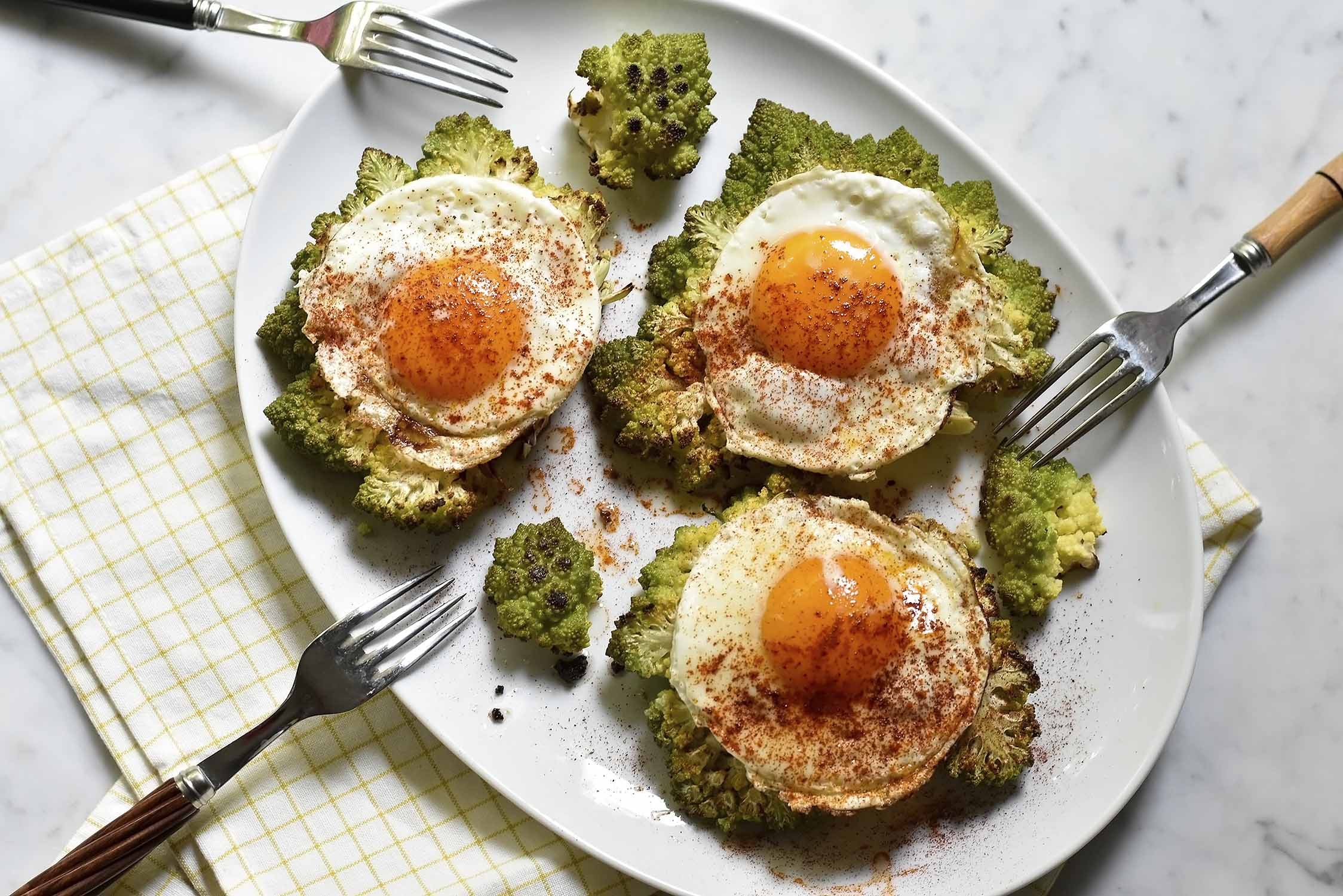 My romanesco slice topped with a fried egg and smoked paprika